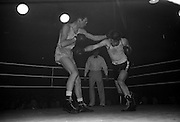 25/01/1963<br /> 01/25/1963<br /> 25 January 1963<br /> National Junior Boxing Championships at the National Stadium, Dublin. Picture shows W. Quinlan (U.C.D.) and  D. Burns (Crown) in the final for the Middleweight Junior Championship.
