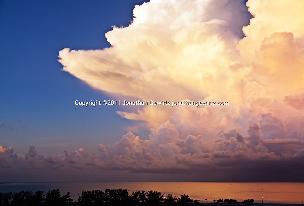 Towering thunderstorm clouds over the ocean. WATERMARKS WILL NOT APPEAR ON PRINTS OR LICENSED IMAGES.
