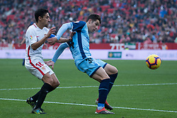 December 16, 2018 - Seville, Andalucia, Spain - Jesus Navas of Sevilla Fc and Valery of Girona competes for the ball during the LaLiga match between Sevilla FC and Girona at Estadio Ramón Sánchez Pizjuán on December 16, 2018 in Seville, Spain  (Credit Image: © Javier MontañO/Pacific Press via ZUMA Wire)