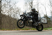 Bill Dragoo accellerates his BMW R1200GS Adventure out of a hairpin curve in Missouri.