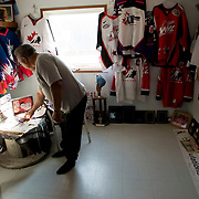 Jordin Tootoo grew up in a small village along the Hudson Bay only a hundred miles from the Arctic Circle. The first Inuit to play professionally in the National Hockey League, Tootoo is close to his family and friends to nearly everyone in Rankins Inlet in Northeast Canada. Jordin's older brother, a top hockey player in the region, committed suicide. The family keeps an empty bedroom as a shrine to the Tootoo brothers. <br /> <br /> Image available for licensing and for a personal print. Please Add To Cart and select the size and finish. All prints are delivered directly to you from the printer.