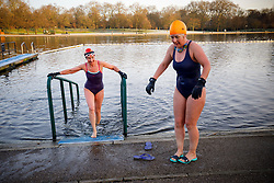 © Licensed to London News Pictures. 03/01/2017. London, UK. People swim in The Serpentine Lake in Hyde Park, London on a frosty morning as temperatures in the capital drop below zero celsius on Tuesday, 3 January 2017. Photo credit: Tolga Akmen/LNP