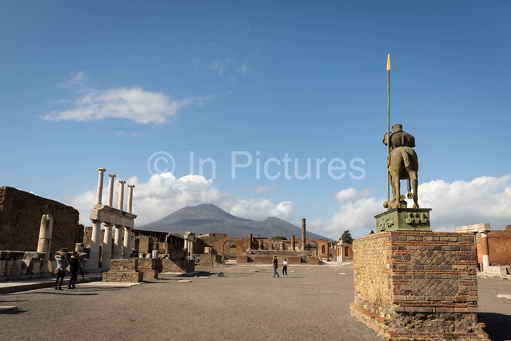 People explore the almost-deserted Forum at the Pompeii Archeological Park on Friday 6th March 2020 in Pompei, Italy. Park officials estimate that visitor numbers are down to a sixth of what they would normally be as a result of the spread of Coronavirus, which has prompted the closure of all Italian schools and universities, and the postponing of many sporting events. .