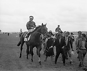 Irish Derby 1973 Irish Derby 1973 The Curragh Raccourse  --(Horse) Weavers' Hall –  Jockey is George McGrath, Lady leading in horse, I think is Rosemary McGrath but I will confirm that. <br />
