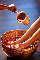A traidiontal foot cleansing purifies and refreshes before a treatment at Fivelements Healing Center in Bali, Indonesia. Spa photographer: Djuna Ivereigh.