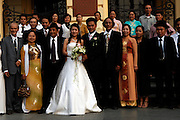Newlyweds have the family photographs taken on the steps of the Opera House in the French Quarter of Hanoi, former capital of Indochine (French Indochina).