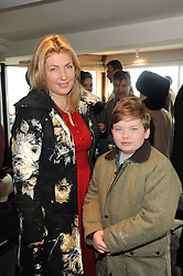 The COUNTESS OF CARNARVON and her son the HON.EDWARD HERBERT at the Hennessy Gold Cup 2010 at Newbury Racecourse, Berkshire on 27th November 2010.