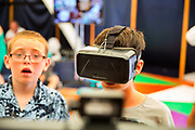 Shangri La is a festival of contemporary performing arts held each year within Glastonbury Festival. The theme for the 2015 Shangri La was Protest. Boy watches another boy playing a virtual reality game