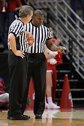29 November 2014:  Referees Terry Davis and Winston Stith discuss a situation during a time out at a NCAA men's basketball game between the Youngstown State Penguins and the Illinois State Redbirds  in Redbird Arena, Normal IL.