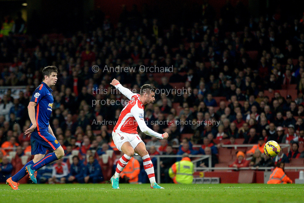 Olivier Giroud of Arsenal scoring his teams first goal of the game.Barclays Premier league match, Arsenal v Manchester Utd at the Emirates Stadium in London on Saturday 22nd November 2014.<br /> pic by John Patrick Fletcher, Andrew Orchard sports photography.