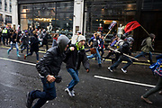 Young teenage students run from police against government education cuts in Regent Street. Holding a variety of splinter marches, students were campaigning against plans to raise tuition fees in England to up to £9,000 per year, with a vote expected in the House of Commons before Christmas. Police arrested 153 people during clashes in London on the third day of protests against plans to raise student tuition fees. The day ended with a stand-off with police in Trafalgar Square.