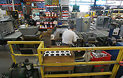 Interior view of a part of the assembly line for manufacturing gas stoves at Empire Comfort Systems. The Belleville manufacturing firm is celebrating its 80th anniversary.