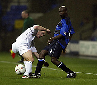 Photo. Aidan Ellis.<br />Bolton Wanderers v Gillingham.<br />Carling Cup 3rd Round.<br />28/10/2003.<br />Bolton's Henrik Pedersen and Gillingham's Ian Cox