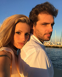 """Michelle Hunziker releases a photo on Instagram with the following caption: """"The two of us....dopo una giornata con le Beb\u00e8 meravigliose...attimi preziosi insieme...un abbraccio \u2764\ufe0f\u2764\ufe0f\u2764\ufe0f @therealtrussardigram"""". Photo Credit: Instagram *** No USA Distribution *** For Editorial Use Only *** Not to be Published in Books or Photo Books ***  Please note: Fees charged by the agency are for the agency's services only, and do not, nor are they intended to, convey to the user any ownership of Copyright or License in the material. The agency does not claim any ownership including but not limited to Copyright or License in the attached material. By publishing this material you expressly agree to indemnify and to hold the agency and its directors, shareholders and employees harmless from any loss, claims, damages, demands, expenses (including legal fees), or any causes of action or allegation against the agency arising out of or connected in any way with publication of the material."""