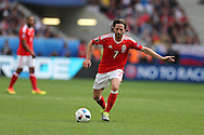 Joe Allen of Wales in action. Euro 2016, Wales v Slovakia at Matmut Atlantique , Nouveau Stade de Bordeaux  in Bordeaux, France on Saturday 11th June 2016, pic by  Andrew Orchard, Andrew Orchard sports photography.