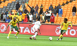 South Africa: Johannesburg: Bafana Bafana players Sandile Hlanti and Percy Tau battle for the ball with Seychelles player Jude Nancy during the Africa Cup Of Nations qualifiers at FNB stadium, Gauteng.<br />Picture: Itumeleng English/African News Agency (ANA)