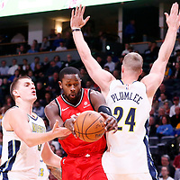 01 November 2017: Toronto Raptors forward CJ Miles (0) drives past Denver Nuggets center Mason Plumlee (24) and Denver Nuggets center Nikola Jokic (15) during the Denver Nuggets 129-111 victory over the Toronto Raptors, at the Pepsi Center, Denver, Colorado, USA.