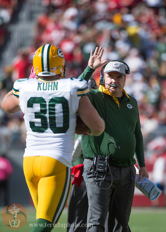 October 4, 2015; Santa Clara, CA, USA; Green Bay Packers head coach Mike McCarthy (right) congratulates fullback John Kuhn (30) for scoring a touchdown during the third quarter against the San Francisco 49ers at Levi's Stadium. The Packers defeated the 49ers 17-3.