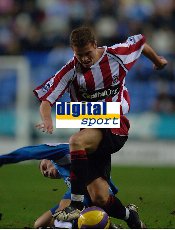Photo: Paul Greenwood.<br />Wigan Athletic v Sheffield United. The Barclays Premiership. 16/12/2006. Wigan's David Cotterill, left, makes a last ditch tackle on Sheffield's Chris Armstrong