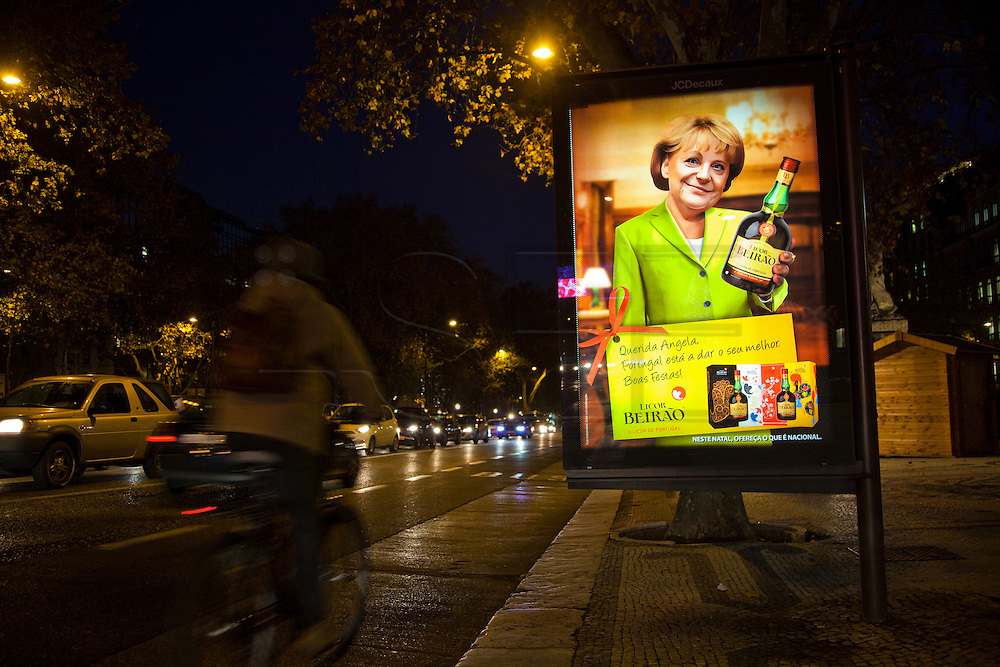 """A Portuguese company advertises its liquor brand using digital composed images of German Chancellor Angela Merkel and French President Nicolas Sarcozy holding a Licor Beirão bottle, it can be read in the muppie among other things, """"Dear Angela. Portugal is giving its best. Happy Holidays."""" , in Lisbon, Portugal. 27/12/2011 IN SALES IN PORTUGAL"""