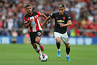 Football - 2019 / 2020 Premier League - Southampton vs. Manchester United<br /> <br /> Andreas Pereira of Manchester United and Southampton's Sofiane Boufal in action during the Premier League match at St Mary's Stadium Southampton  <br /> <br /> COLORSPORT/SHAUN BOGGUST