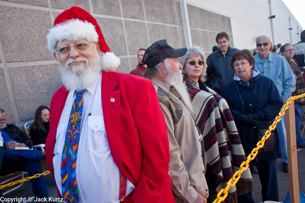 """Dec. 1, 2009 -- TEMPE, AZ: TEX EVERETT, from Salom, AZ, waits in a Santaesque suit to get Sarah Palin's autograph at the Costco in Tempe. Former Alaska Governor Sarah Palin signed copies of her book, """"Going Rogue"""" at a Costco in Tempe, AZ, Tuesday. More than one thousand people showed up for the signing. About 150 of them spent the night at the store. Palin did not make any comments or speak to the address during her appearance in Tempe.  Photo by Jack Kurtz"""