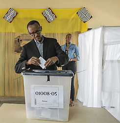 KIGALI, Dec. 19, 2015 (Xinhua) -- Rwandan President Paul Kagame casts his ballot at a polling station for the constitutional referendum in Kigali, Rwanda, Dec. 18, 2015. Rwandans Friday went to the polls on constitutional referendum to allow President Paul Kagame to seek re-election after his second year seven-year term expires in 2017. (Xinhua) (Credit Image: © Xinhua via ZUMA Wire)