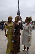 Paris and Nicky Hilton with their mother. Atelier Versace show, Theatre National de Chaillot. Paris. © Copyright Photograph by Dafydd Jones 66 Stockwell Park Rd. London SW9 0DA Tel 020 7733 0108 www.dafjones.com