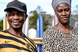 """Police Operations and Essential Services Personnel operating under lockdown period in Fish Hoek and Masipumelela in the Cape Peninsula, near Cape Town, Western Cape, South Africa, RSA <br /> <br /> Phindi Ndlati & her husband Thembelani Mfunda - who lost his job due to Covid-19, spent their last cash on a meagre plastic bag of provisions from Foodzone (low income market). """"Now we do not have money to buy any more food, so I don't know what we will do now,"""" Phindi says, with pride battling uncertainty as she gazes beyond the lens."""