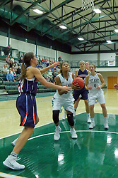 06 December 2017:  Raven Hughes under the hoop defended by Kelly Lawson during an NCAA women's basketball game between the Wheaton Thunder and the Illinois Wesleyan Titans in Shirk Center, Bloomington IL