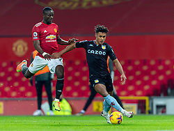 MANCHESTER, ENGLAND - Friday, January 1, 2020: Aston Villa's Ollie Watkins (R) and Manchester United's Eric Bailly during the New Year's Day FA Premier League match between Manchester United FC and Aston Villa FC at Old Trafford. The game was played behind closed doors due to the UK government putting Greater Manchester in Tier 4: Stay at Home during the Coronavirus COVID-19 Pandemic. (Pic by David Rawcliffe/Propaganda)