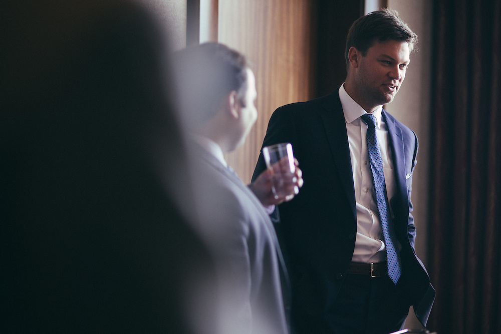 Young adult man discussing finance in a corporate meeting.