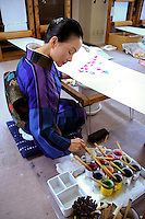 """Kimono designer painting on silk. Kimono are hand made, which is in part why they are so expensive.  The kimono is the traditional clothing of Japan. Originally the word """"kimono""""  meant """"thing to wear"""" but now has come to denote a particular type of traditional full-length Japanese garment."""