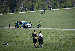 © Licensed to London News Pictures. 05/04/2020. London, UK. Police officers in a car and on bikes patrol Hampstead Heath, London, during a pandemic outbreak of the Coronavirus COVID-19 disease. The public have been told they can only leave their homes when absolutely essential, in an attempt to fight the spread of coronavirus COVID-19 disease. Photo credit: Ben Cawthra/LNP