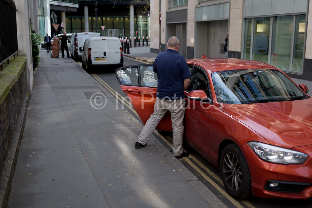 A man makes a quick toilet stop in a quiet side street in the City, a quick pee in the Square Mile, the capitals financial district, on 3rd March 2017, in the City of London, England.