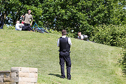 © Licensed to London News Pictures. 06/05/2020. London, UK. Police talk to members of the public in Markfield Park, Tottenham in north London. The coronavirus lockdown continues to slow the spread of COVID-19 and reduce pressure on the NHS.  Photo credit: Dinendra Haria/LNP