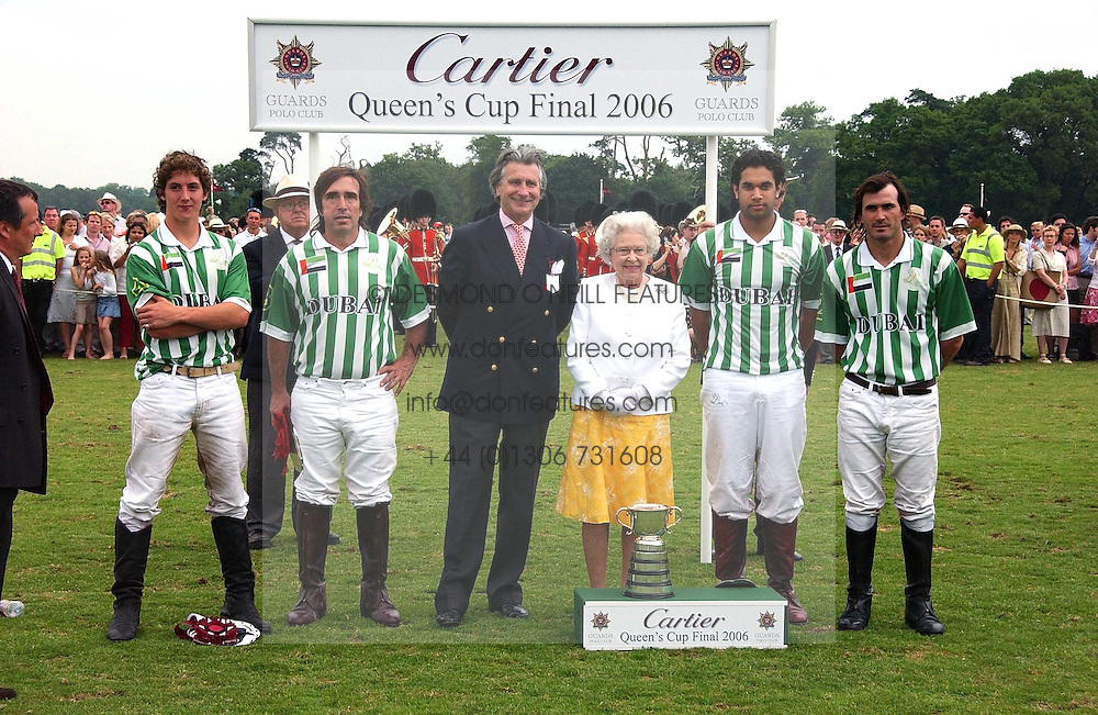 HM THE QUEEN ELIZABETH 11 and ARNAUD BAMBERGER MD of Cartier with the victorious Dubai polo team at the Queen's Cup polo final sponsored by Cartier at Guards Polo Club, Smith's Lawn, Windsor Great Park on 18th June 2006.  The Final was between Dubai and the Broncos polo teams with Dubai winning.<br /><br />NON EXCLUSIVE - WORLD RIGHTS