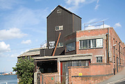 """""""Free the Quay"""" slogan painted on old maltings building Mistley, Essex, England - a campaign to restore public access to the privately owned quayside"""