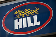 Sign for the gambling brand William Hill in Birmingham, United Kingdom.