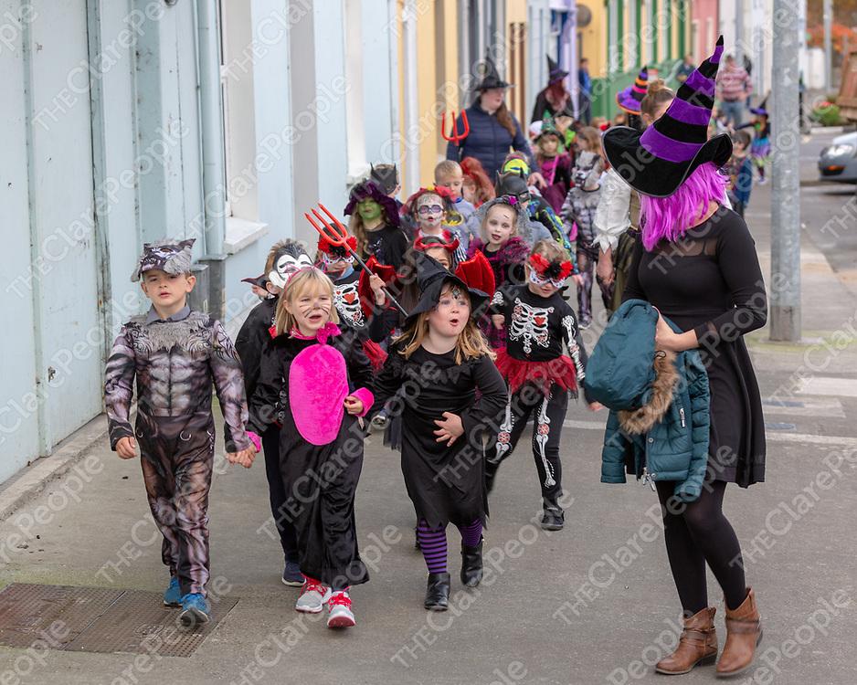Children from St Senans NS take part in the Halloween Hobble through the town on Thursday morning