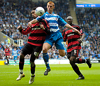 Photo: Ed Godden.<br /> Reading v Queens Park Rangers. Coca Cola Championship. 30/04/2006. Steve Sidwell (C) is challenged by QPR's Richard Langley (L).