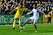 Jake Jervis (10) of AFC Wimbledon has his cross blocked by Kyle Bennett (23) of Bristol Rovers during the EFL Sky Bet League 1 match between Bristol Rovers and AFC Wimbledon at the Memorial Stadium, Bristol, England on 23 October 2018.