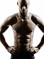 one young african muscular build man topless silhouette isolated on white background