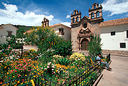 PERU, HIGHLANDS, CUZCO a beautiful small square with traditional Spanish Colonial churchs and palaces built  on Inca stonework foundations