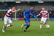 AFC Wimbledon striker Kweshi Appiah (9) dribbling during the The FA Cup match between AFC Wimbledon and Doncaster Rovers at the Cherry Red Records Stadium, Kingston, England on 9 November 2019.