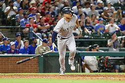 May 22, 2018 - Arlington, TX, U.S. - ARLINGTON, TX - MAY 22: New York Yankees left fielder Giancarlo Stanton (27) hits a grounder to reach first base during the game between the Texas Rangers and the New York Yankees on May 22, 2018 at Globe Life Park in Arlington, Texas. The Rangers defeat the Yankees 6-4. (Photo by Matthew Pearce/Icon Sportswire) (Credit Image: © Matthew Pearce/Icon SMI via ZUMA Press)