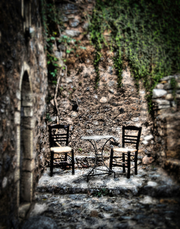 Table and two chairs in Monemvasia