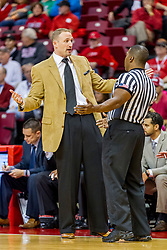29 November 2014:  No, they aren't getting ready for a hug... Dan Muller questions a call with referee Winston Stith during an NCAA men's basketball game between the Youngstown State Penguins and the Illinois State Redbirds  in Redbird Arena, Normal IL.