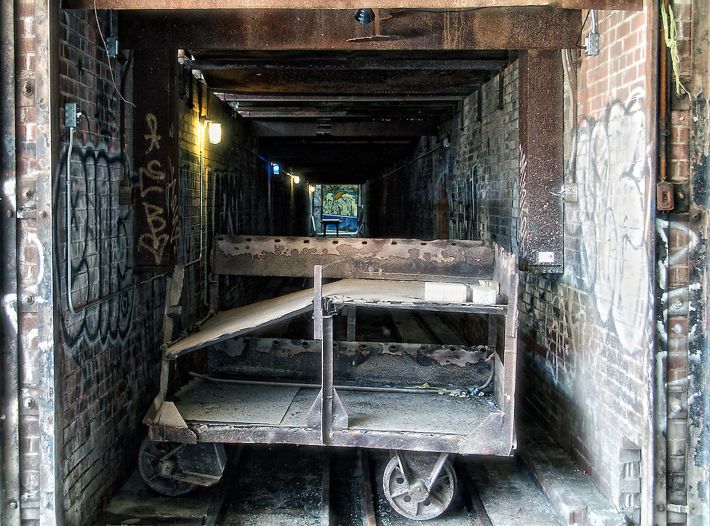 """Carts were used to move bricks in and out of drying tunnels and kilns, part of the Holcim Gallery, Evergreen Brick Works, Toronto (Canada).<br /> <br /> """"Building 16"""" at the Brick Works housed several massive kilns built in the 1960s for firing and drying bricks. The kilns were fascinating artifacts, but their sheer size – 600 linear metres occupying three-quarters of the building – made the space impossible to use.<br /> <br /> Dissecting the kilns to reveal their hidden spaces and internal workings, opened up the building, providing space for a large-scale contemporary venue (Holcim Gallery), and at the same time tells the story of this historic space.<br /> <br /> Visitors can now access and explore the various interior spaces of the kilns, and learn about the different stages of firing brick: preheating, firing, and cooling. The rich, industrial masonry of this site is brought to life by a simple but strategic process of deconstruction and interpretation."""