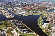 Nederland, Groningen, Gemeente Groningen, 01-05-2013; Oosterhogebrug, met woonschepenhaven en woontoren Tasmantoren, de binnenstad in de achtergrond. Knooppunt van waterwegen: Eemskanaal (onder en links), begin van Van Starkenborghkanaal met Oostersluis.<br /> View on the city of Groningen, residential tower Tasmantoren , Eemskanaal crossing Van Starckenborghkanaal (channels) and business park. <br /> luchtfoto (toeslag op standard tarieven)<br /> aerial photo (additional fee required)<br /> copyright foto/photo Siebe Swart